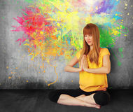 Woman yoga meditation. Young attractive woman sitting in lotus position doing yoga meditation Royalty Free Stock Image