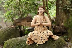 Woman yoga in nature Royalty Free Stock Image