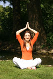 Woman in yoga pose. A young woman practicing her yoga poses Royalty Free Stock Images