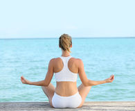 Woman in a yoga pose Royalty Free Stock Images