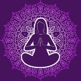 Woman in a yoga pose on the background circular ornament Royalty Free Stock Photo
