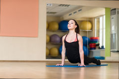 Woman yoga pose in bhanga Asana, Cobra Pose Royalty Free Stock Image