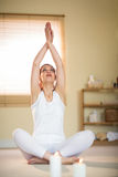 Woman in yoga pose with hands joined Royalty Free Stock Photos