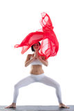 Woman in yoga pose and red flying fabric isolated Royalty Free Stock Image