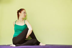 Woman in yoga pose Royalty Free Stock Photos