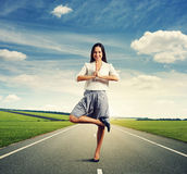 Woman in yoga pose standing on the road Royalty Free Stock Photography