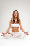 Woman in yoga pose in studio on white background Royalty Free Stock Photo