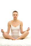 Woman in yoga position Stock Photo