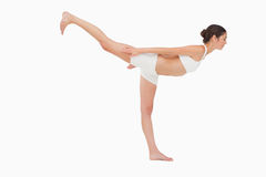 Woman in yoga position Royalty Free Stock Photo