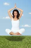 Woman in yoga position Stock Image