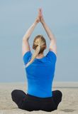 Woman in yoga position from behind Stock Photography