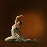Woman in yoga position. Lakini stock image