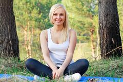 Woman in yoga position, outdoor Royalty Free Stock Image
