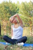 Woman in yoga position, outdoor Royalty Free Stock Photo