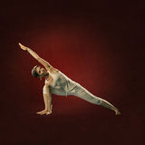 Woman in yoga position. Parsva Kona Royalty Free Stock Photo