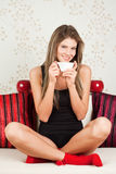 Woman in yoga position with tea Stock Image