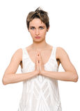 Woman yoga prayer. Portrait of a young  woman praying on white background Stock Photography