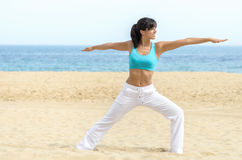 Woman yoga relax on beach Stock Photos