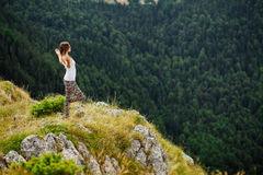 Woman yoga relax at the end of earth in fascinating landscape Royalty Free Stock Photography