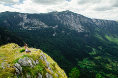 Woman yoga relax at the end of earth in fascinating landscape Royalty Free Stock Images