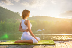 Woman Yoga - relax in nature.  stock photo