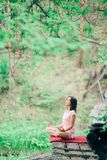 Woman Yoga, relax in nature. Forest summer Royalty Free Stock Photo