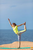 Woman yoga. Series. Outdoor. On the seashore Stock Image