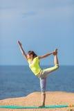 Woman yoga. Series. Outdoor. On the seashore Stock Image