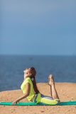 Woman yoga. Series. Outdoor. On the seashore Stock Photos