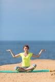 Woman yoga. Series. Outdoor. On the seashore Royalty Free Stock Image