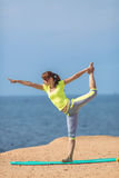 Woman yoga. Series. Outdoor. On the seashore Stock Photo