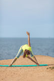 Woman yoga. Series. Outdoor. On the seashore Royalty Free Stock Photography