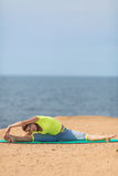 Woman yoga. Series. Outdoor. On the seashore. Healthy woman resting and curl up in fetal position outdoor at the sea: yoga pose. Series royalty free stock photos
