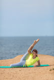 Woman yoga. Series. Outdoor. On the seashore Royalty Free Stock Images