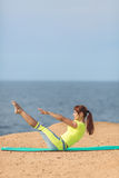 Woman yoga. Series. Outdoor. On the seashore Royalty Free Stock Photo
