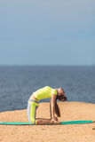 Woman yoga. Series. Outdoor. On the seashore. Healthy woman resting and curl up in fetal position outdoor at the sea: yoga pose. Series stock images