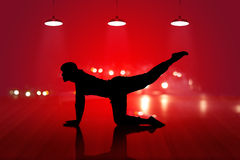 Woman yoga silhouette exercise on wooden floor red background Royalty Free Stock Photos