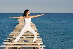 Woman , yoga or tai chi. Woman stretching doing yoga or tai chi on summer holiday vaction Stock Image