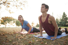 Woman yoga trainer demonstrating to student Stock Photography