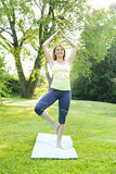 Woman in yoga tree pose Stock Images