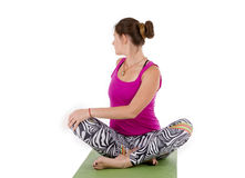 Woman  yoga twist. Woman making yoga in twist pose on mat Stock Images
