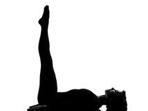 Woman yoga Upward Extended Feet Pose - urdhva prasarita padasana Royalty Free Stock Images