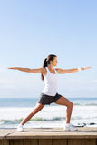 Woman yoga warrior pose Royalty Free Stock Photography