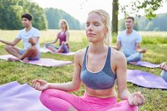 Woman in yoga workshop meditating stock photos