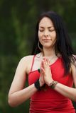 Woman Yogi Stands with Hands In Prayer Stock Photography