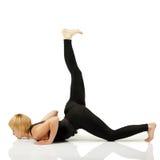Woman yogi in yoga pose stock photo