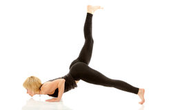 Woman yogi in yoga pose royalty free stock photography