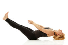 Woman yogi in yoga pose on white stock images