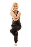 Woman yogi in yoga pose on white stock photography