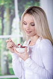 Woman with yogurt bowl Stock Image